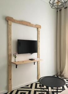 A television and/or entertainment center at Apartment Muñoz 1