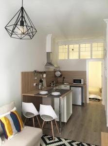 A kitchen or kitchenette at Apartment Muñoz 1