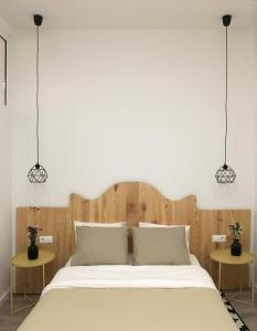 A bed or beds in a room at Apartment Muñoz 1