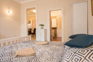 A bed or beds in a room at Your Home In Budapest 3BR