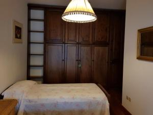 A bed or beds in a room at Villetta Miramonti