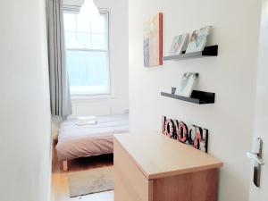 A bed or beds in a room at Highbury & Islington Hub