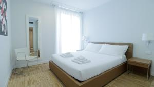 A bed or beds in a room at Italianway-B7