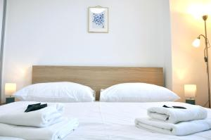 A bed or beds in a room at Bratislava Apartment Prievozska