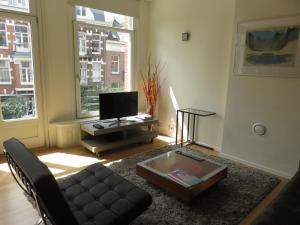 A television and/or entertainment center at Great Apartment Vondelpark B