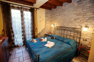 A bed or beds in a room at Casa Sonvico