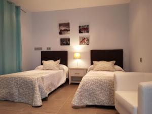 A bed or beds in a room at Villa Margarita
