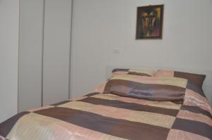A bed or beds in a room at Sarajevo City Center