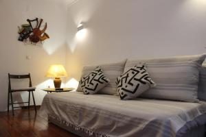 A bed or beds in a room at Apartamento S. Miguel Alfama