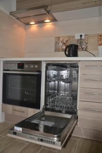 A kitchen or kitchenette at Sarajevo City Center