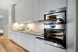A kitchen or kitchenette at Crocetta Apartment