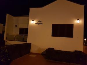 A television and/or entertainment center at Villa Margarita