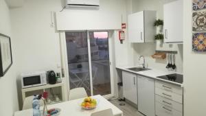 A kitchen or kitchenette at Porto Center Apart