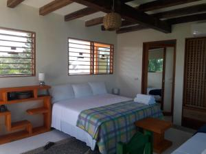 A bed or beds in a room at Condo-Hotel Romaya