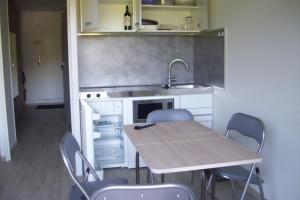 Cuisine ou kitchenette dans l'établissement Bel appart modern au pied du grand Veymont