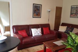 A seating area at 3 bedroom west end flat with parking
