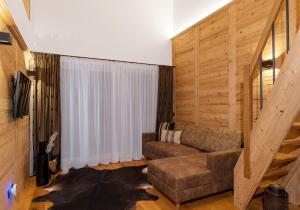 A seating area at Bock's Apartment-Arlberg-Chalets