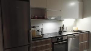 A kitchen or kitchenette at Feels Like Home Laajalahti