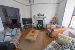 A seating area at Holiday House Pembroke Dock