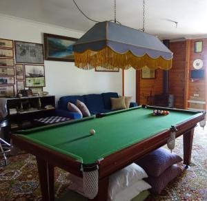 A pool table at Cobden Crest Cottages