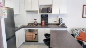 A kitchen or kitchenette at Depto en La Serena Condominio Pacifico 1