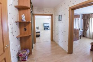 Телевизор и/или развлекательный центр в Home Apartments on prospekte Octabrya