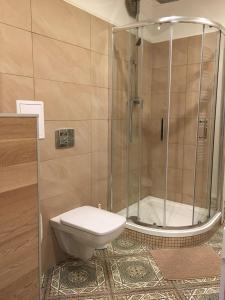 A bathroom at modern,light,clean 1Room Apartment central