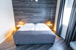 A bed or beds in a room at Acco Luxury Apartments