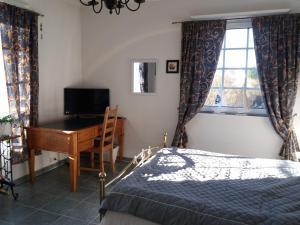 Säng eller sängar i ett rum på Villa Emilia