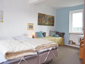 Ein Bett oder Betten in einem Zimmer der Unterkunft Holiday Home Patersberg
