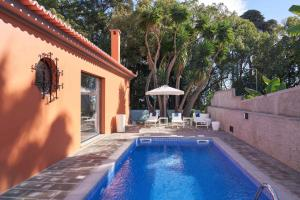 The swimming pool at or near Funchal Charming Villa