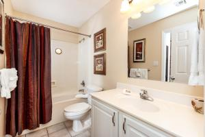 A bathroom at Gulf Dunes 504 Apartment