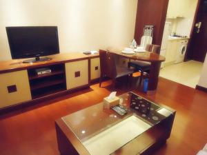 A television and/or entertainment center at Ziyuan Service Apartment