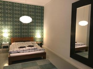 A bed or beds in a room at Mopsbox