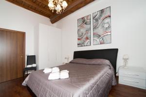 Ένα ή περισσότερα κρεβάτια σε δωμάτιο στο 64 Suites Apart