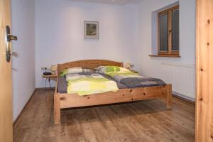 A bed or beds in a room at Apartment Bachmaier