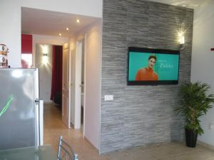Een TV en/of entertainmentcenter bij Lovely Bungalow