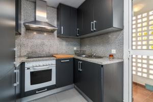 A kitchen or kitchenette at Valle Romano Golf Apartment