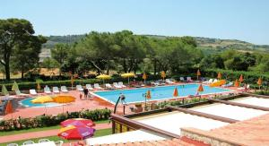 A view of the pool at Villaggio Residence La Pieve di Pomaia or nearby