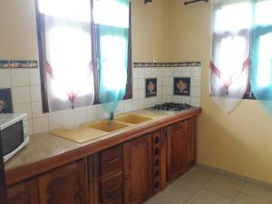 A kitchen or kitchenette at couleur douceur 2