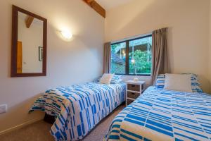 A bed or beds in a room at By the Bay Beachfront Apartments