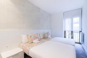 Cama o camas de una habitación en BUENPAS. Apartment by the Cathedral
