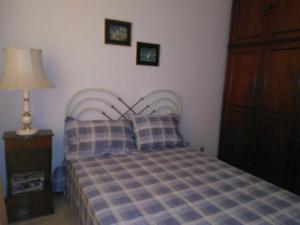 A bed or beds in a room at Copacabana Apartamento - Ouro