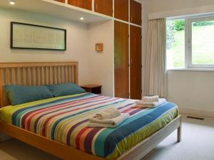 A bed or beds in a room at Unerigg