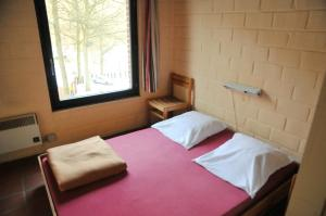 A bed or beds in a room at Domaine Du Bonsoy