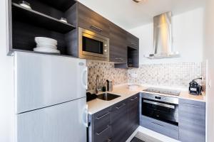Una cocina o zona de cocina en Lizzy apartment