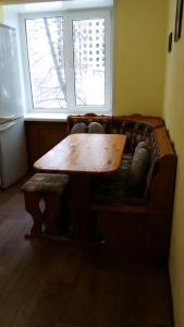A seating area at Apartment on Iyulskikh Dney 18