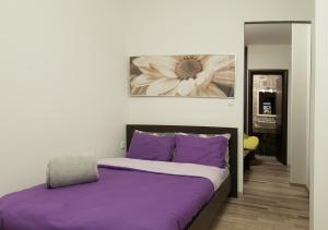 A bed or beds in a room at Home Suites
