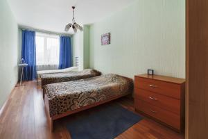 A bed or beds in a room at ALLiS-HALL One-Bedroom Apartment at Radischeva 33