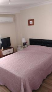 A bed or beds in a room at One Bedroom Apartment in Kusadasi City Center